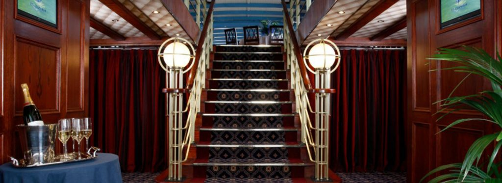 Mississippi Paddle Steamer Boat - Luxury Boat Hire on the River Thames in London. Staircase leading to upper deck.